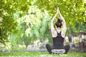 Young woman doing yoga exercises — Stock Photo