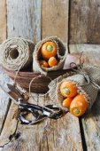 Carrots wrapped in burlap — Stock Photo