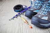 Boots and fishing gear — Stock Photo