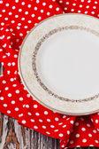 Vintage plate on red kitchen towel  — Foto de Stock