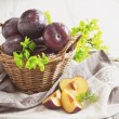 Ripe plums in a basket — Stock Photo #75358365