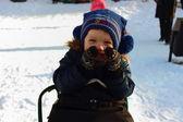 Little boy on a sled — Stock Photo