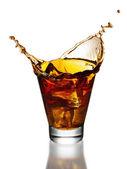 Cola splash in a glass — Stock Photo