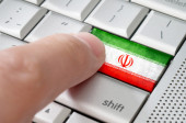 Business concept male finger pressing Iran enter key on metallic — Stock Photo