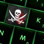 Online crime scene with a finger print left on backlit keyboard — Stock Photo #63434453