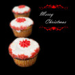 Merry Christmas cup cakes card against black background — Stock Photo #63434579