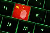 Online crime scene with a finger print left on backlit keyboard  — Stock Photo