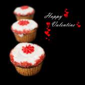 Happy Valentine cupcakes against dark background — Stock Photo