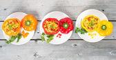 Three stuffed chorizo Paella a rice dish flavoured with paprika  — Stock Photo
