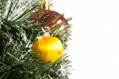 Christmas tree with snow and baubles — Stock Photo