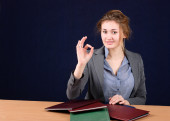 Businesswoman showing ok sign at office — Stock Photo