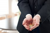 Businessman holding Euro coins — Stock Photo