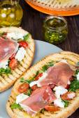 Grilled bruschetta with prosciutto ham — Foto Stock