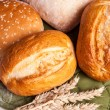 Baked bread rolls with wheat ears — Stock Photo #79110484