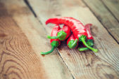 Very spicy peppers, chili, cayenne, jalapeno, peperoncino on woo — Stockfoto