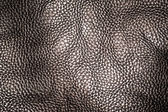 Creased and wrinkled black leather for background — Stock Photo