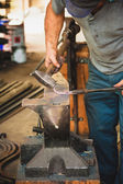 Hard and dirty work at a blacksmith — Stock Photo