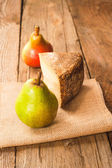 Two pears accompanied by pecorino cheese, Italian delicacy — Stock Photo