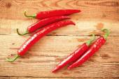 Fresh and spicy chili peppers on a wooden rustic table Vintage — Stock Photo