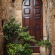 The door in the alley of the old Tuscan town, Italy — Stock Photo #55326011