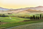 The setting sun over the valley of the Orcia in Tuscany, Italy — Stock Photo