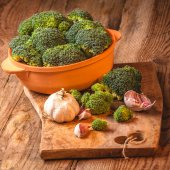 Green delicious broccoli on a wooden rustic table — Stock Photo