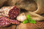 Sausage salami in a rural setting — Stock Photo