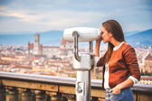 Beautiful girl impressed view the panorama of Florence in autumn — Stock Photo