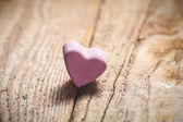 The pink heart on a wooden rustic table as background — Stock Photo