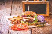 Juicy and fragrant hamburger with fries homemade copy space for  — Stock Photo