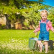 Little Girl and cat play on a green meadow in spring beautiful d — Stock Photo #71896809