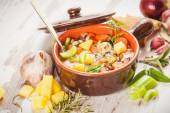 Rural vegetarian broth soup with colorful vegetables and rustic — Stock Photo