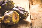 Fresh vegetables, artichoke on a wooden rustic background — Stock Photo