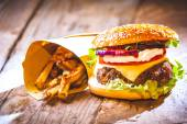 Delicious burger and chips, hand-made in the house on rustic tab — Stock Photo