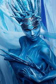 Painted woman in headwear — Stock Photo