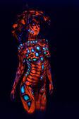 Freak girl in ultraviolet costume — Stock Photo