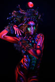 Woman with ultraviolet body art — Stock Photo