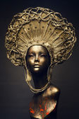 Mannequin in golden headwear — Stock Photo