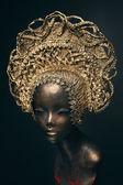 Mannequin in golden head wear — Stock Photo