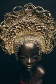 Mannequin in golden head wear — Стоковое фото
