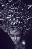 Mannequin in metallic headwear with chains — Stock Photo