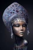 Mannequin in blue head wear with beads — Stock Photo