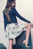 Woman in denim jacket and skirt — Stock Photo