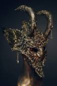 Scary steel mask with horns — Stock Photo