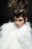 Woman in headwear and fur coat — Stock Photo