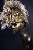 Mannequin in head wear with feathers — Stock Photo