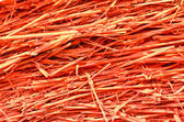 Close up of straw paint red colour background texture — Stock Photo