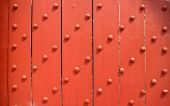 Old Wooden door, reinforced with metallic bolts.  — Stock Photo