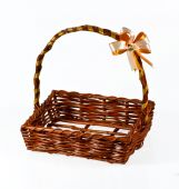 Empty wicker basket with bow isolated on white background  — Stock Photo