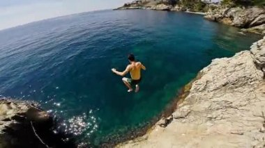 Athletic Young Man Jumping From Cliff Into Ocean Sea Water Muscular Adventure Extreme Sports Lifestyle Hobby Vacation Clear Beach Slow Motion Leisure Activity Gopro HD — Stock Video